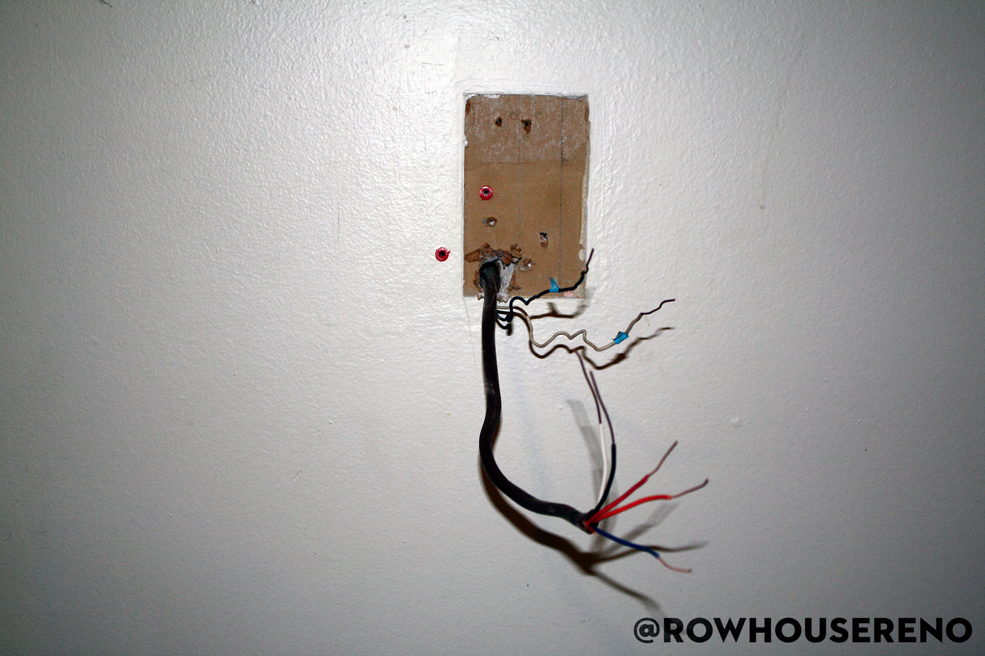 Installing a new thermostat wire - Row House Reno